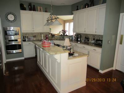 Here is a recent cabinet refacing project completed in for Kitchen cabinets 63021