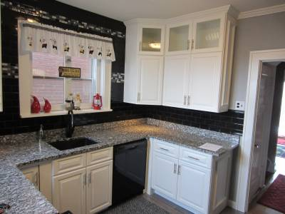 St.Louis kitchen cabinet refacing with added glass door accents