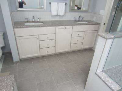 Before and after photos of a bathroom remodel in Clayton, MO