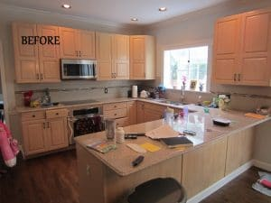 Before and after photos of a cabinet refacing project in St.Louis