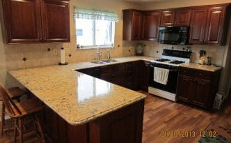 Cabinet Refacing Project done by Cabinet Coverup using dark hardwoods