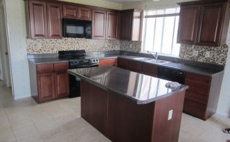 cherry wood refacing project in kitchen with hardwoods